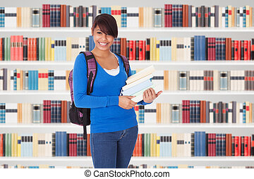 Young College Student Girl In A Library With Books In Front...