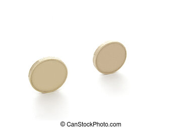 StillLife-12-0012 - Two blank coins isolated on a white...