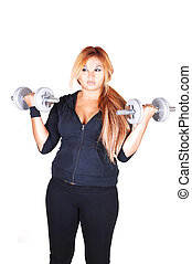 Red hair woman with dumbbells - A young girl in a black...