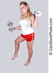 Blond hair woman with dumbbells - A young girl in a red...
