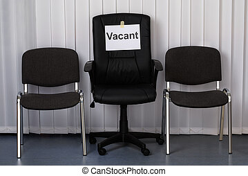 Office Chair With A Vacant Sign At Work Place