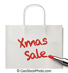 Xmas sale words written by red lipstick