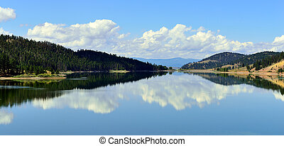 lake and reflection of clouds in Montana near Glacier...