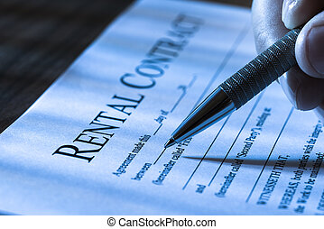 Filling Rental Agreement Form - Close-up Of A Person Filling...