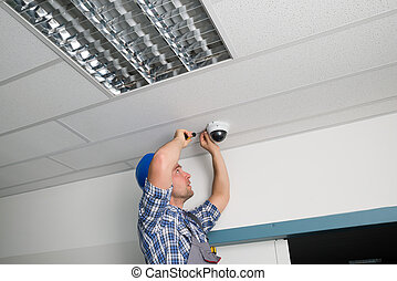 Technician Fixing Security Camera - Close-up Of Male...