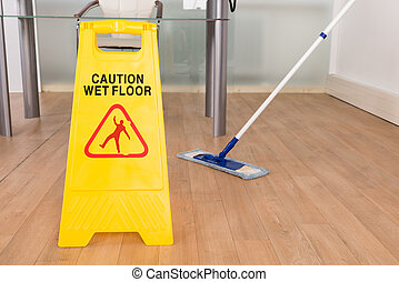 Wet Floor Sign And Mop - Close-up Of Wet Floor Sign And Mop...