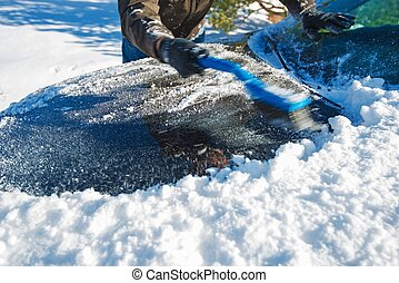 Snow Removal From Car. Men Cleaning Car From the Snow.