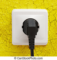Wall plug socket on cracked wall - Wall plug socket on...