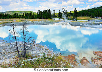 Clouds reflecting in the Sapphire pool in Biscuit Basin in...