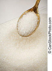 Heap of white sugar and spoon - Heap of white sugar and...