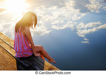 Dreams - Young girl on the pier