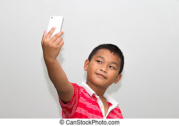 kid taking a selfie with cell phone - Little kid taking a...