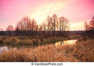 sunrise over the river late autumn