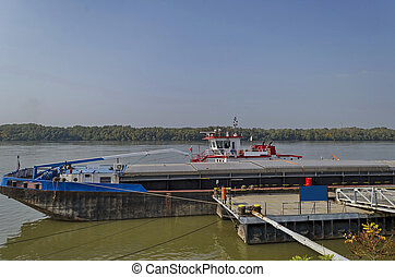 River cargo boat at pontoon in Ruse Danube port, Bulgaria