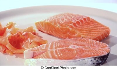 Raw salmon slices rotating