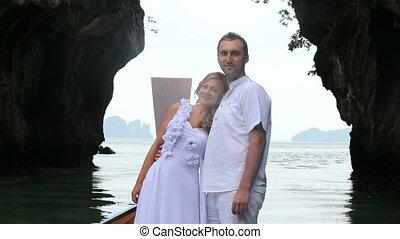 bride put her head on husband's shoulder - blonde bride put...