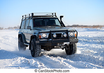 Winter SUV ride - Classic SUV traveling in the snow