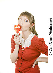 attractive girl with heart lolly pop