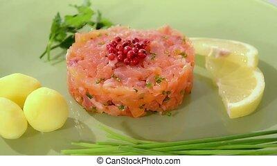 Salmon tartare on green plate - Salmon tartare with...