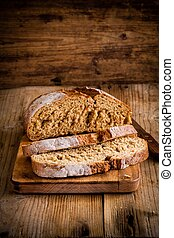 fresh rye bread on a rustic wooden background