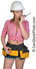 Woman in hard hat and tool belt talking on radio