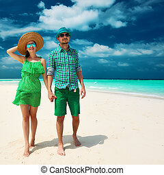Couple in green on a beach at Maldives - Couple in green on...
