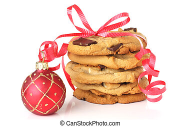 Christmas cookies wrapped with red ribbon and an ornament....
