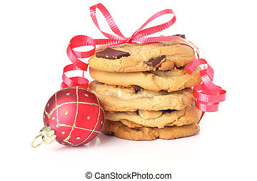 Christmas cookies wrapped with red ribbon and an ornament...