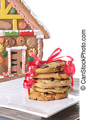 Christmas cookies in front of a gingerbread house cookie jar...