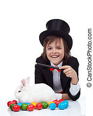 The magic of easter - happy magician boy and grumpy rabbit -...