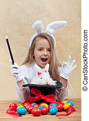 Little magician girl conjuring easter items - Little...
