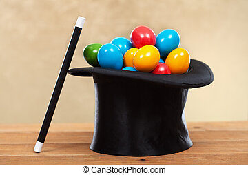 The magic of easter - colorful eggs in magician hats on...