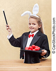 Behold the red easter eggs - little magician bunny girl with...