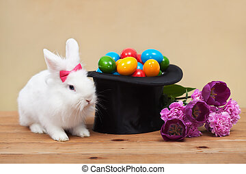Easter bunny with spring flowers and colorful eggs - Easter...