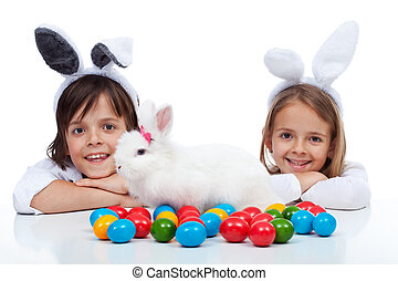 Happy kids at easter time - wearing bunny ears and guarding...