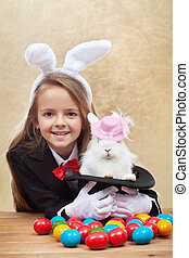 Happy magician girl holding cute bunny in magic hat - Happy...