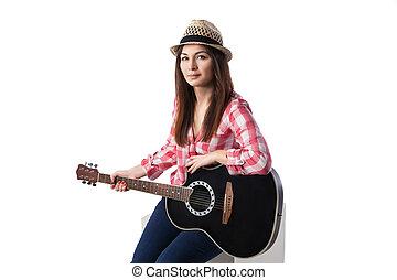 Closeup of young woman musician with guitar. - Closeup of...