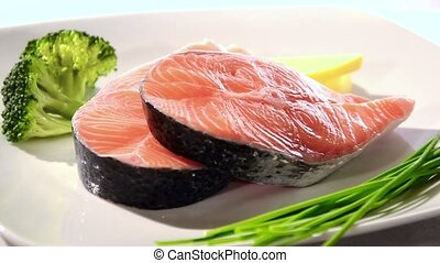 Salmon steaks with broccoli - Raw salmon steaks on white...
