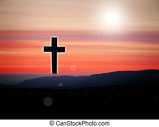 Jesus Christ on the cross in the sunset landscape