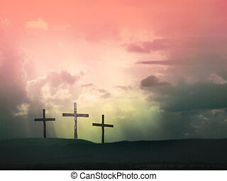 Jesus Christ on the cross - Three crosses against dramatic...