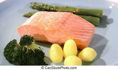 Steamed salmon with vegetables - Steamed salmon on a blue...
