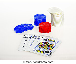 Colorful poker chips and face cards from a deck