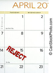 April calendar stamped REJECT on tax day
