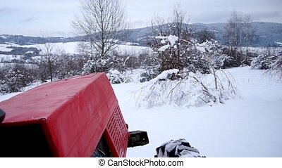 Tractor on the road over the frozen snow, with chains on...