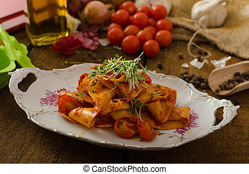 Pasta arrabiata with chilli and garlic organic, microgreens...