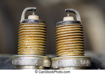 Close up of two spark plug tips