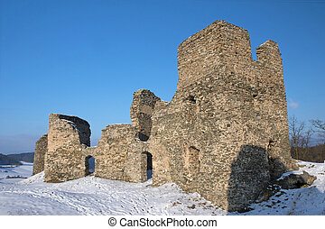 Ruins of the ancient stone castle in winter.