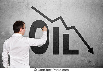 drawing falling oil chart - businessman drawing falling oil...