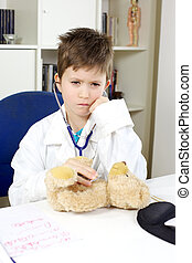Serious child doctor at work with bear plush