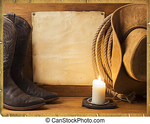 Vintage American background with cowboy clothes and old...